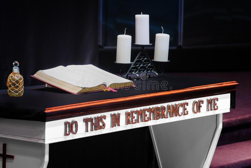 Communion Table With Bible and Candles in Christian Church stock photos