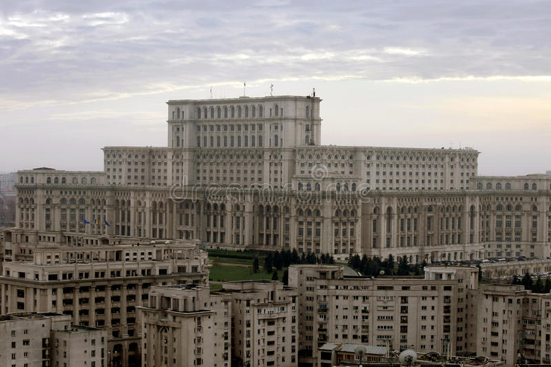 Communist buildings in Bucharest, Romania. The Romanian Parliament from Bucharest, Romania, also called House of the People surrounded by buildings of communist royalty free stock photo