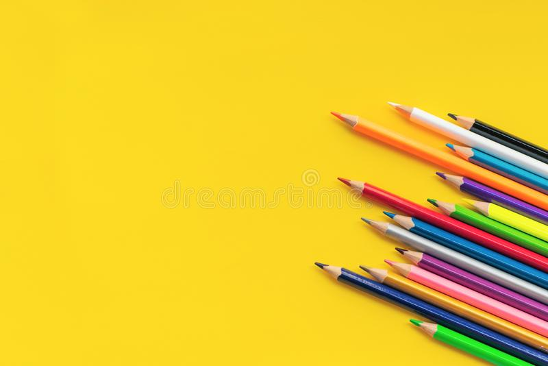 Community communication concept. Group of pencils on the yellow background with copy space stock photo