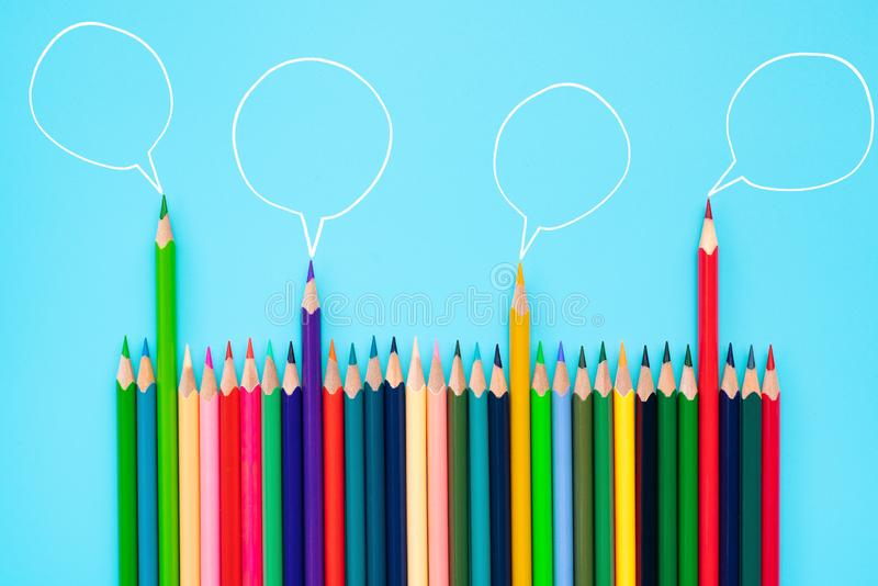 Community communication, represents people conference, social media interaction & engagement. group of pencils sharing idea. On blue background with copy space stock images