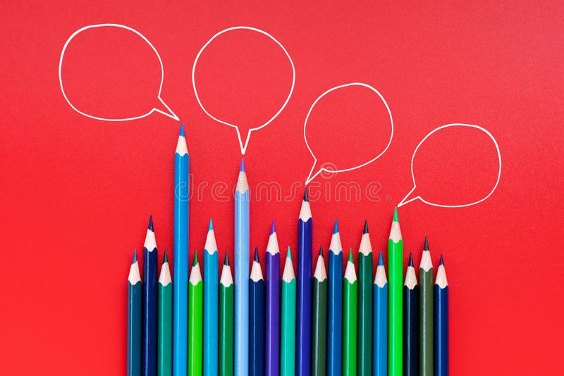 Community communication, represents people conference, social media interaction & engagement. group of pencils sharing idea. On red background with copy space royalty free stock photography