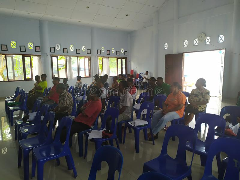 Community meeting about cleanliness at biak-papua. Biak, Papua - 17 August 2019 one afternoon all the janitors street sweepers held a meeting to clean up the stock photo