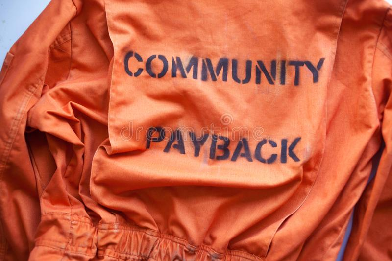 Community payback. Prison clothes, jumpsuit sentenced to correctional labor, criminal penalties. Community payback. close up. Prison clothes, jumpsuit sentenced royalty free stock photography