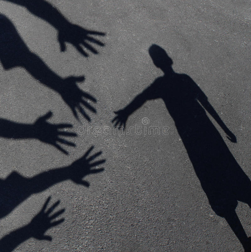 Community Support. And helping children concept with shadows of a group of extended adult hands offering help or therapy to a child in need as an education vector illustration