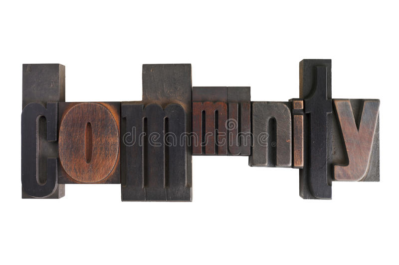 Community, word written in letterpress type blocks. Word community in vintage wooden letterpress type, scratched and stained, isolated on white background royalty free stock photography