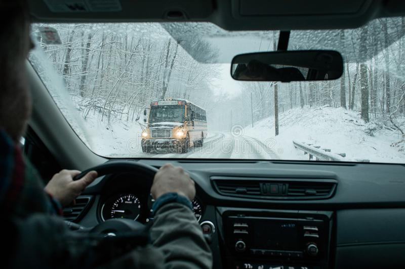 A commuter driving in a winter snow storm royalty free stock photos