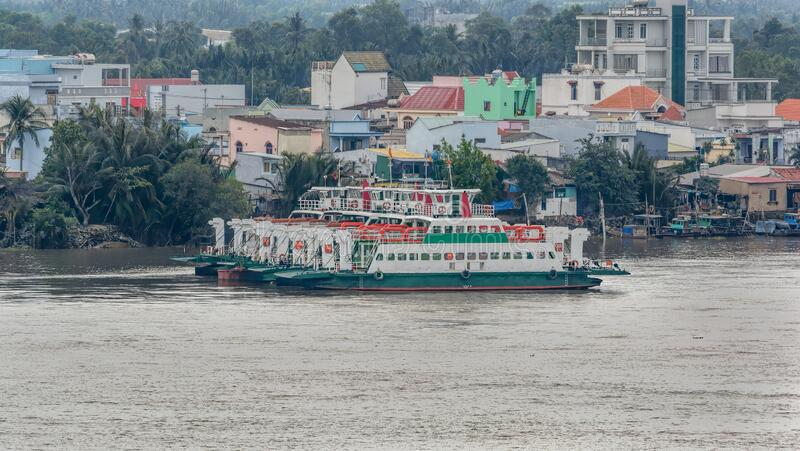 Commuter ferries moored on the banks of Dong Nai River in suburb of Ho Chi Minh City Saigon, Vietnam. Commuter ferries moored on the banks of Song Dong Nai Dong royalty free stock photography