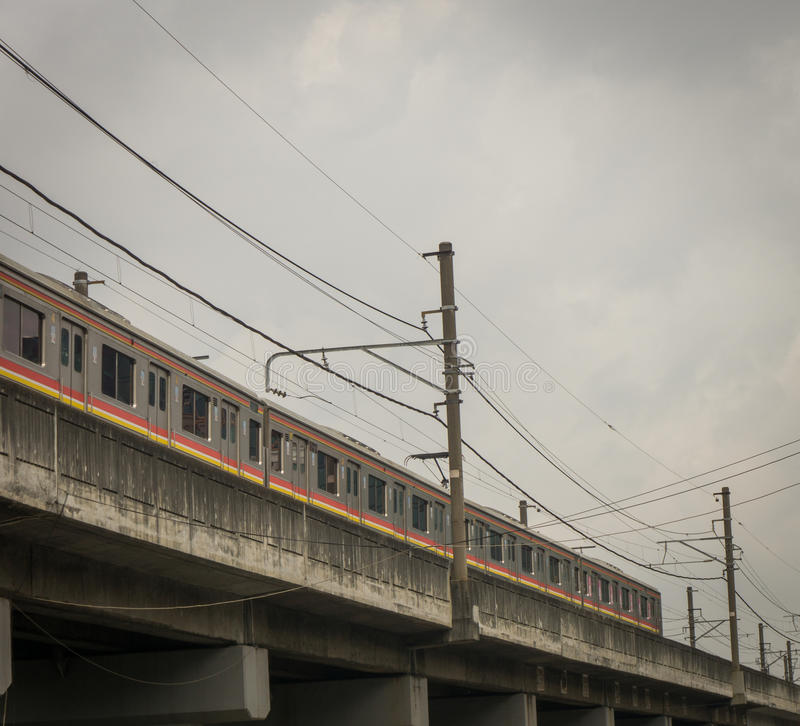A commuter line passing trough an overpass photo taken in Jakarta Indonesia. Java royalty free stock photography