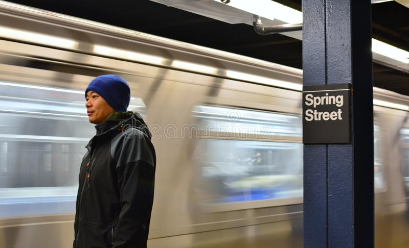 Commuter Man Waiting for Train on NYC Subway Platform Commute to Work in the City royalty free stock photos