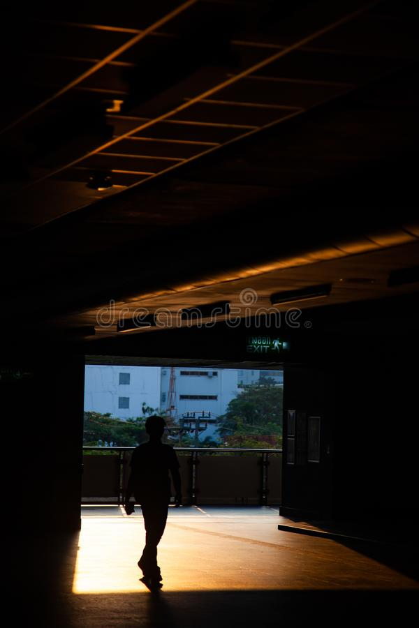 Commuter silhouettes in a station in early morning. Railway, architecture, railroad, transportation, travel, train, people, sky, passenger, urban, reflection stock images