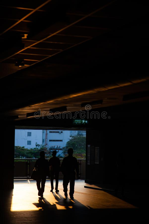 Commuter silhouettes in a station in early morning. Railway, architecture, railroad, transportation, travel, train, people, sky, passenger, urban, reflection royalty free stock images