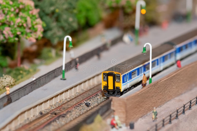 Commuter train. Miniature model commuter train in a station with shallow d.o.f stock photos