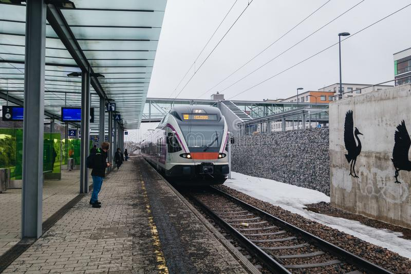 Commuter train from the airport arriving to the station at Leinelä at Vantaa Finland. Editorial 03.25.2019 Vantaa Finland. Commuter train from the airport royalty free stock photography
