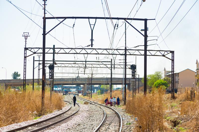 Commuter Train moving through the heart of Soweto, Johannesburg. Soweto, South Africa - September 08 2018: Commuter Train moving through the heart of Soweto stock photo