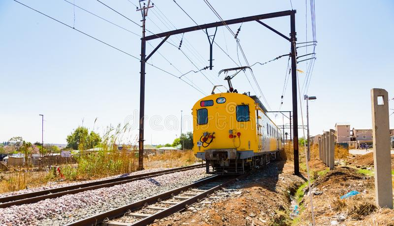 Commuter Train moving through the heart of Soweto, Johannesburg. Soweto, South Africa - September 08 2018: Commuter Train moving through the heart of Soweto royalty free stock photos