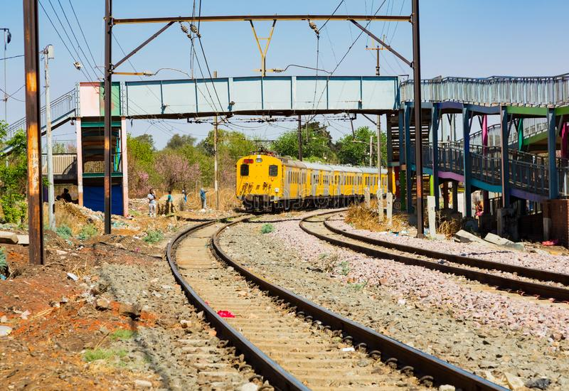 Commuter Train moving through the heart of Soweto, Johannesburg. Soweto, South Africa - September 08 2018: Commuter Train moving through the heart of Soweto royalty free stock images