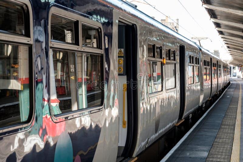Commuter train waiting on platform 1 stock image
