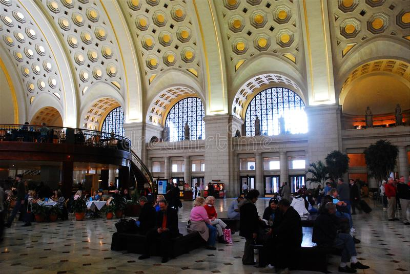 Union Station Waiting Room. Commuters await the next train under the arched ceiling of the Union Station waiting room in Washington, DC stock photo