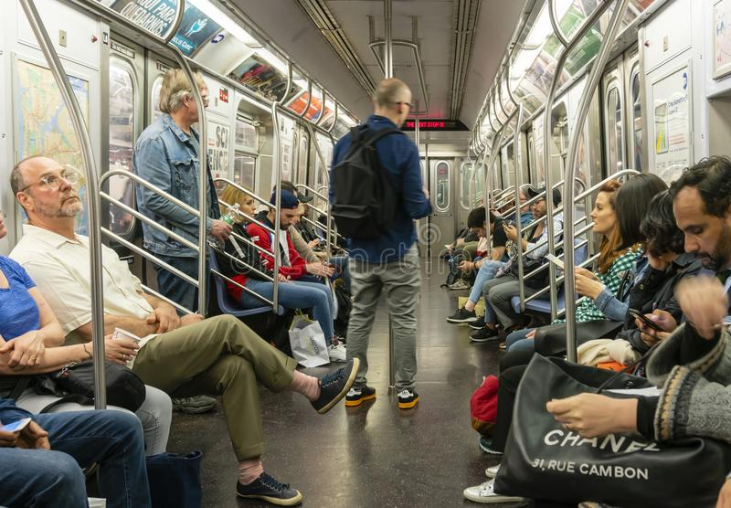 Commuters travelling in a subway train in New York City stock images