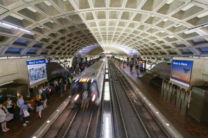 Commuters waiting for train at a Metro station in Washington DC. Washington DC, USA - May 18, 2018: Commuters waiting for train at a Metro station in Washington stock image