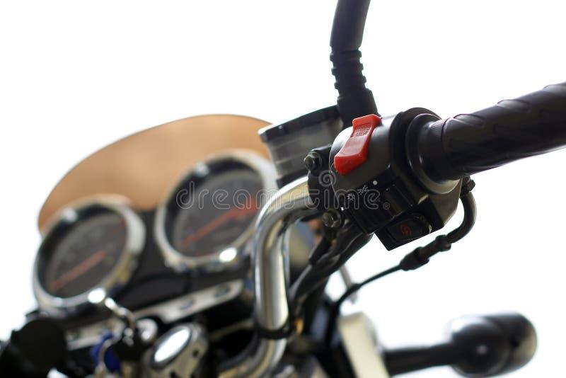 Commuti il bottone fuori eseguito sul motociclo immagini stock