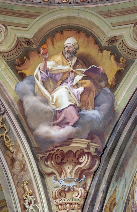 COMO ITALIEN: Freskomålningen av den St Augustine doktorn av den västra katolska kyrkan i kyrkliga Santuario del Santissimo Croci fotografering för bildbyråer