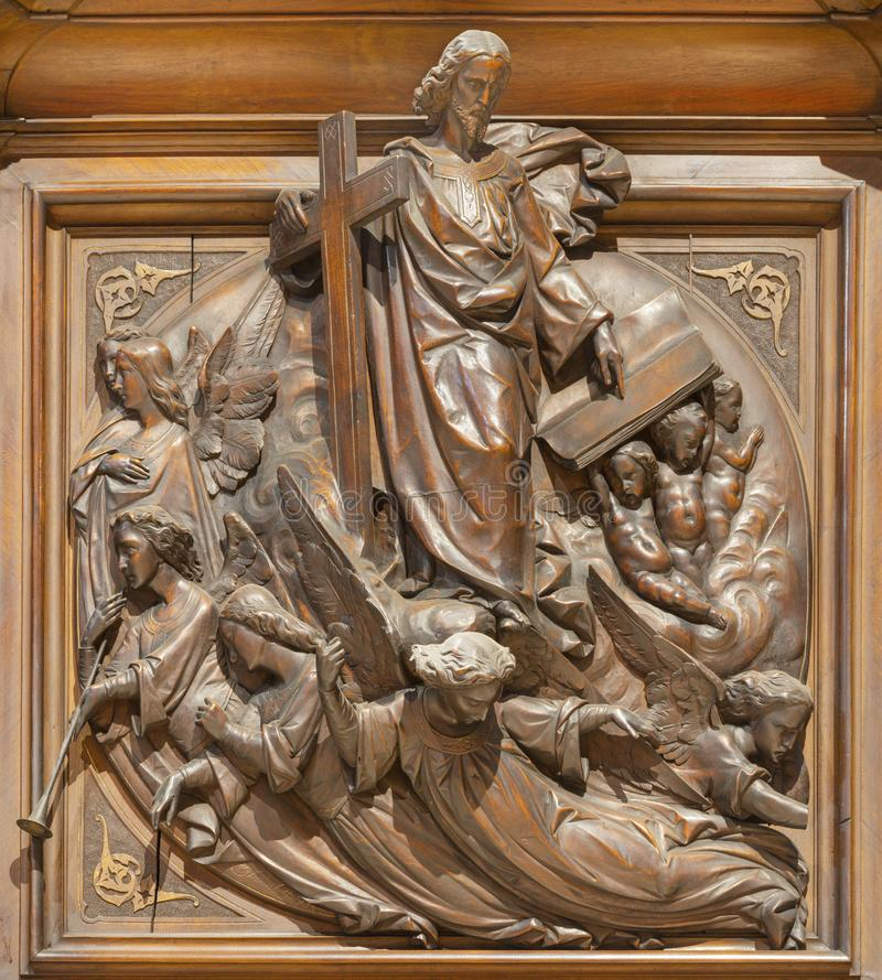 COMO, ITALY - MAY 8, 2015: The carved wooden relief of Last Judgment on the pulpit of church Santuario del Santissimo Crocifisso royalty free stock photos