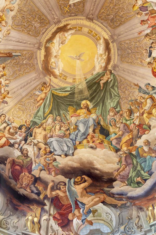 COMO, ITALY - MAY 8, 2015: The fresco of Glory of Christ the King in church Santuario del Santissimo Crocifisso by Gersam Turri. 1927-1929 royalty free stock image
