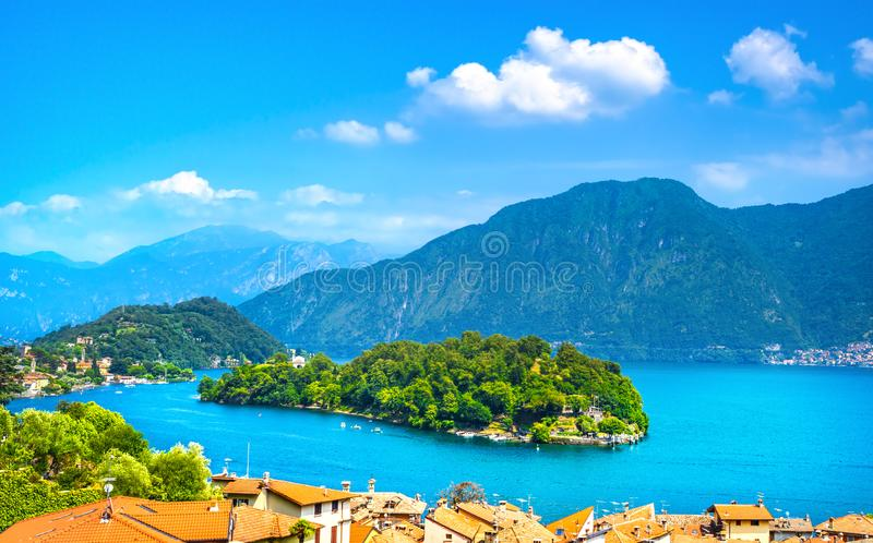 Como Lake, Isola Comacina village and island. Italy. Como Lake, Isola Comacina village, island and Alps mountains. Italy, Europe royalty free stock photography