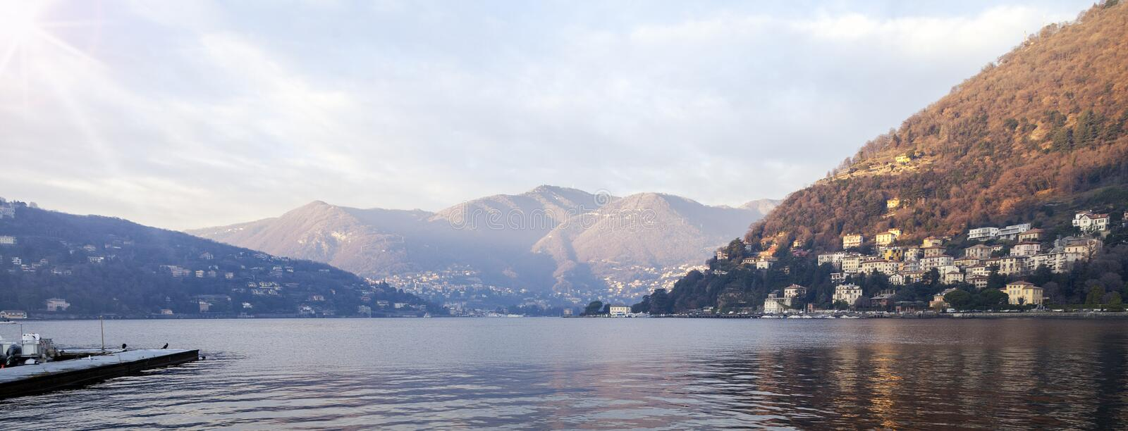 Como Lake wide-angle panorama. Color image. A winter wide-angle view of Como Lake, from Como city lakeside royalty free stock images