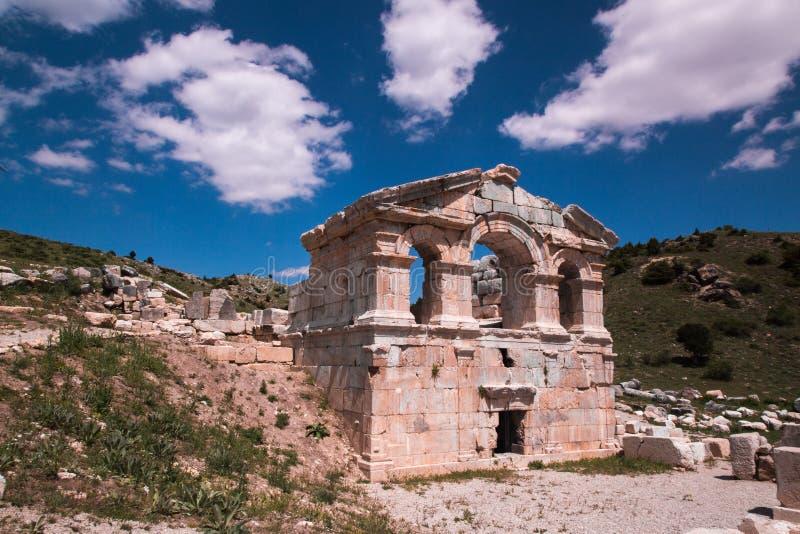Comona Antic City ruins, Tufanbeyli Adana, Turkey. Stone ruins of Comona Antic City in Tufanbeyli Adana, Turkey against blue skies stock images