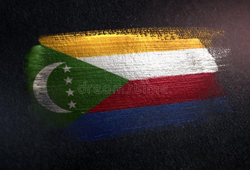 Comoros flagga som göras av metallisk borstemålarfärg på Grungemörkerväggen royaltyfri illustrationer