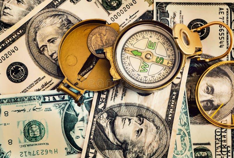 Compás defectuoso puesto en los billetes de banco del dólar de Estados Unidos imagen de archivo libre de regalías