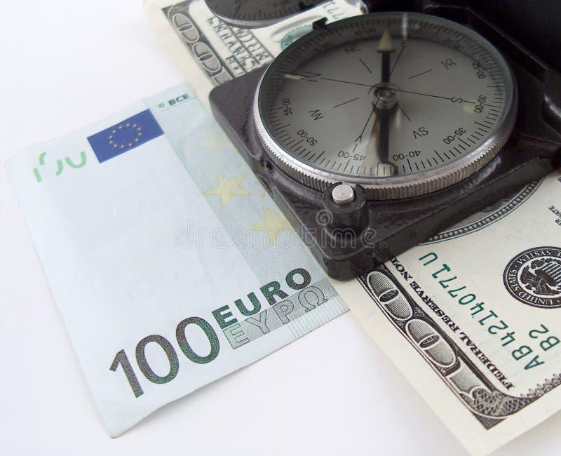 Compás en el dinero fotografía de archivo libre de regalías