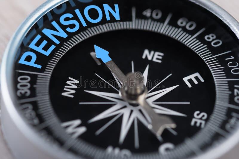 Compás que indica la pensión imagenes de archivo