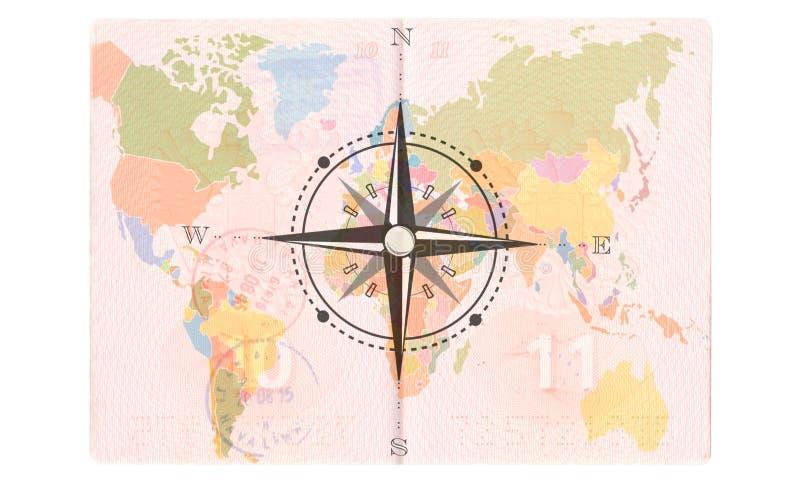 Compás Rose en el pasaporte Mapa del mundo, concepto del viaje foto de archivo