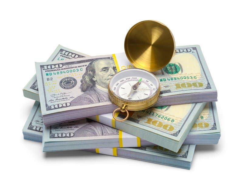 Compás y dinero foto de archivo