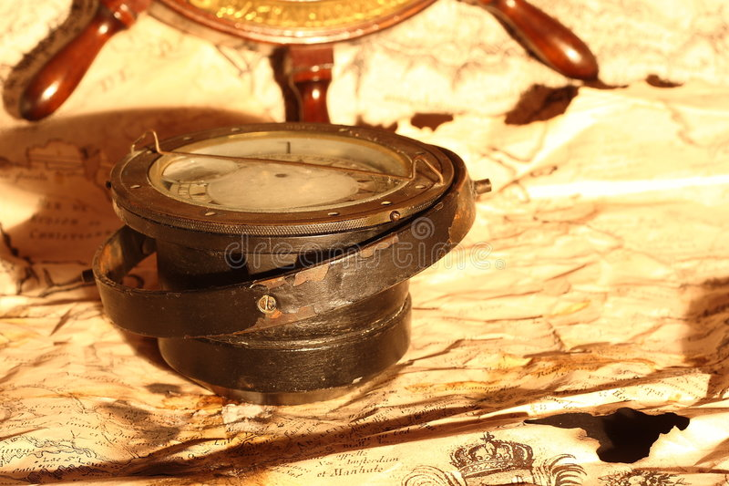 Compás y rueda foto de archivo libre de regalías