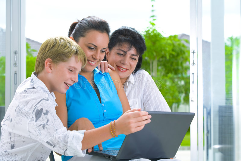 With comp. Portrait of happy family getting busy with laptop royalty free stock photography
