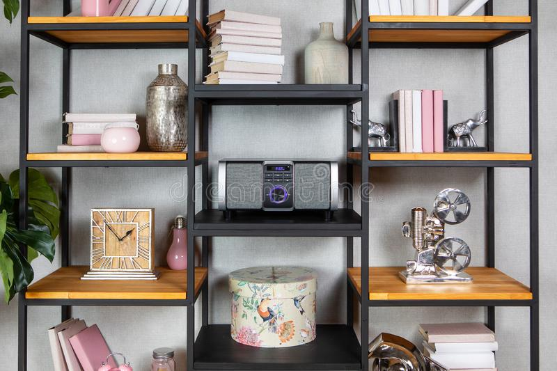 Compact CD radio player on the shelf in vintage interior. Compact CD radio player on the shelf in the vintage interior of the living room royalty free stock photography