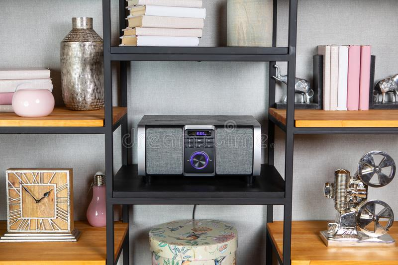 Compact CD radio player on the shelf in vintage interior. Compact CD radio player on the shelf in the vintage interior of the living room royalty free stock photo