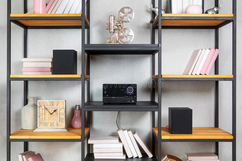 Compact CD radio player on the shelf in vintage interior. Compact CD radio player on the shelf in the vintage interior of the living room stock image