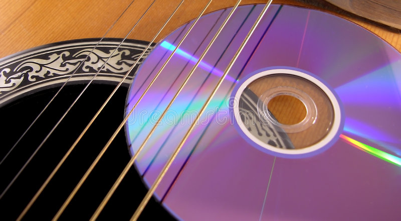 Compact Disc on an Acoustic Guitar
