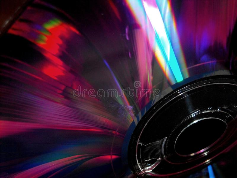 Compact disc. The colors and reflections on a compact disc stock images