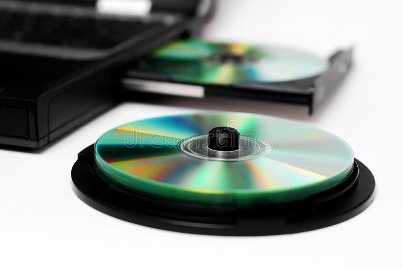 Compact discs. Isolated notebook with compact discs on a white background royalty free stock image