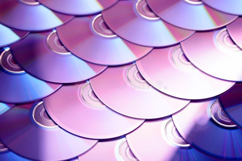 Compact-discsachtergrond Verscheidene schijven blu-Ray van CD dvd Optische recordable of rewritable digitale gegevensopslag royalty-vrije stock afbeelding