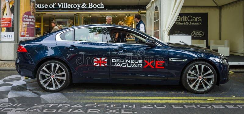 Compact executive car Jaguar XE 20D (since 2015). BERLIN - JUNE 14, 2015: Compact executive car Jaguar XE 20D (since 2015). The Classic Days on Kurfuerstendamm royalty free stock photos