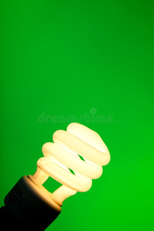 Compact Flourescent On Green Stock Images