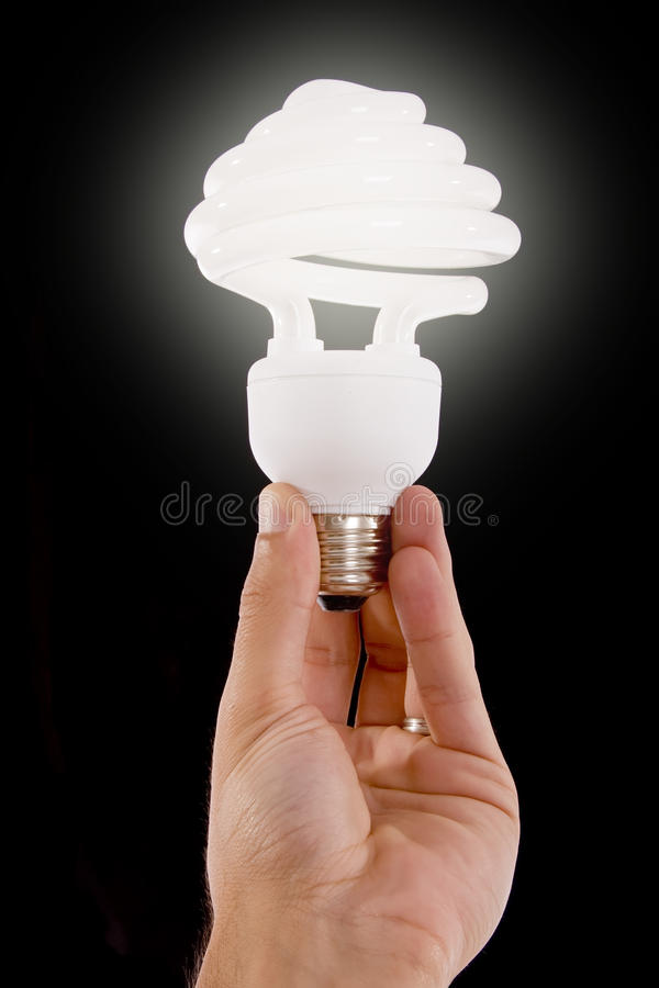 Compact Fluorescent Bulb. On a black background stock image