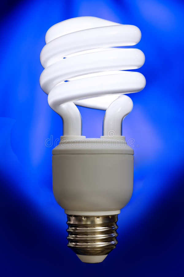 Compact Fluorescent Bulb. Close up of a compact fluorescent light bulb, turned on stock images